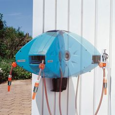 The One Tug Automatic Hose Reel - Hammacher Schlemmer
