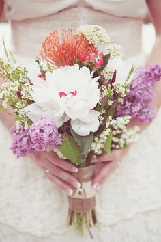 purple and white wedding bouquet // photo by DreamlovePhotography.com