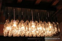 Wine bottle light fixture at the Tutto Gusto Wine Cellar in Epcot