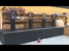 rotating wheel display with lighting in acrylic and wood