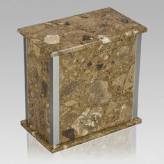 The Designer Rosatica Agglomerate Marble Cremation Urn is assembled from real natural quarried stone. The urn features a stainless steel trim and has a stainless steel or 24k gold plated decoration option. The bottom has felt to protect the surface were the urn stands. This wonderful natural stone urn will create a dignified resting place for eternity to come.