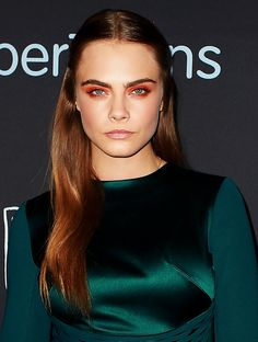 Cara Delevingne's smooth strands and fierce lids