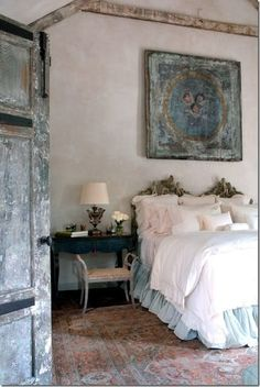 from BohemianWornest; love the traditional French headboard (often made from  what we call twin beds), the overhead plaque can be reproduced using plaster or wood with gesso-same with closet to left- lovely old rugs from family pass down (or 'used' shops)