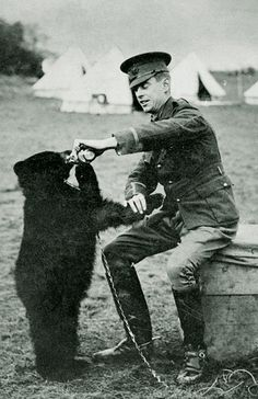 "Lt. Colebourne and Winnie - the bear who became the inspiration for A.A. Milne's ""Winnie the Pooh"" (his son Christopher Robin named his teddy bear after seeing her in the zoo)"