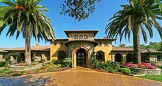 A round driveway and a beautiful Tuscan entrance