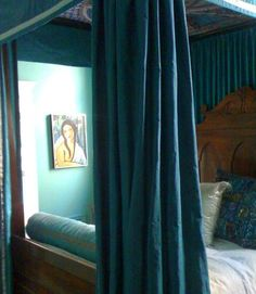 dark peacock green-blue canopy bed with drapes