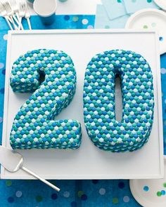 We made this impressive dessert with the magazine's 20th anniversary in mind. Use our templates to cut numbers from sheet cakes. Fill and coat them with buttercream, and then add an orderly procession of candies. Up the dotty effect with confetti and paper plates stamped with food coloring.