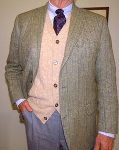 """J. Press handwoven """"Donegal Mist: 3/2 roll jacket cable knit Cardigan vest, and Light gray flannels."""
