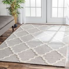 Invoke the feel and warmth of a country home with this stunning woolen hand-hooked rug. Meticulously made using a petit point stitches construction, make your favorite space feel right at home.