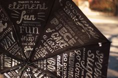 beautiful and whimsical umbrella - with mary poppins quotes underneath! how wonderful.  Get each kid to decorate a triangle for an umbrella to be shown at the end?  :)