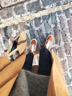 orange vans old skool: Alex Stedman of The Frugality wearing hers with a grey jumper and a pair of black trousers