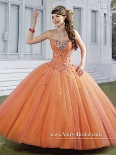 A tulle quinceanera ball gown with strapless sweetheart neclkine, ruched bust, bead embellished bodice, multi-toned gathered skirt, lace-up back, and bolero.