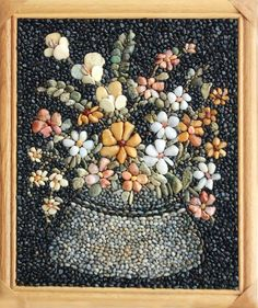 Valentina Sheitanova..amazing flower mosaic made with stones!