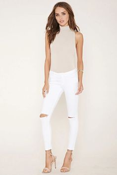 White jeans are a must-have for Spring! This trendy pair from Forever 21 features distressed features!