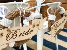 DIY Bride and Groom Chair Back Decorations that look like life preservers.