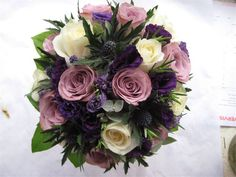 a bouquet of Avalanche roses, lilac Memory Lane roses, blue thistles and fresh lavendel