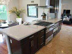 A large kitchen island with quartz countertops distinguishes the eating nook from the kitchen and provides the perfect prep area while entertaining guests, as seen on HGTV's Flip or Flop. Kitchen Island Range, Large Kitchen Island, Island Stove, Kitchen Islands, New Kitchen, Kitchen Dining, Kitchen Ideas, Kitchen Designs, Kitchen Redo