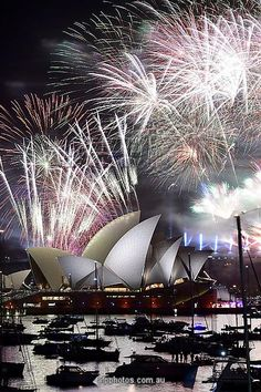 AUSTRALIA-NEW YEAR - Fireworks light up the sky over Sydney's Opera House during Photographic Prints from $19.99
