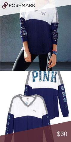 Bling V-neck varsity Tee Colors are navy blue white and gray with blue bling print. Shirt has been worn a few times and in good conditions. If you have any questions or request please leave a comment below! PINK Victoria's Secret Tops Tees - Long Sleeve