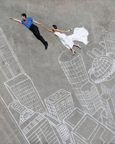 Bride with groom as Superman on chalk city skyline - Picture by Gardner Hamilton