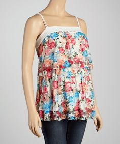 From one trimester to the next, this tank is a flawlessly comfortable addition to a maternity wardrobe.  A lovely floral print and flowing tiers provide a feminine, bump-friendly silhouette.
