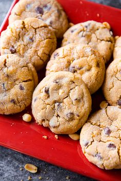 Big peanut butter chunk cookies like you find at a professional bakery! Soft, thick, crinkled, and addicting. Köstliche Desserts, Delicious Desserts, Dessert Recipes, Peanut Butter Cookie Recipe, Peanut Butter Recipes, Homemade Cookies, Yummy Cookies, Chocolate Chip Cookies, Chocolate Chips