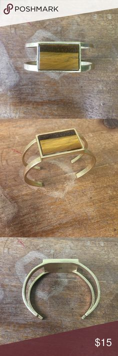 Madewell Tigers Eye Cuff Gold modern cuff from Madewell. Not sure if the actual stone is real tigers eye but it looks like it. I'm very good condition. The metal can be adjusted . Madewell Jewelry Bracelets