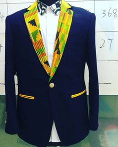 Stand out from the rest and show off your dapper self in this slim fit Kente Cloth Blazer. Check out our Kente ties and bow ties to finish up the look. You can crash any wedding when you rock this bla