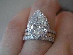 Great idea for my pear shaped diamond ring...add 2 eternity bands!!
