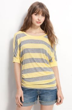 love the longer length of this tee and yellow/gray color combo