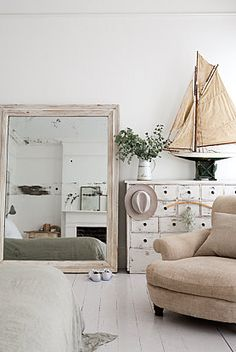 lovveee - the mirror, the bureau, the oversized chair, and the WHITE FLOOR! If we ever refinish the master bedroom floors AGAIN and I'm feeling brave .. i would love to do white!
