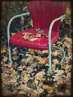 Autumn Chair. Vintage red metal lawn chair with leaves.