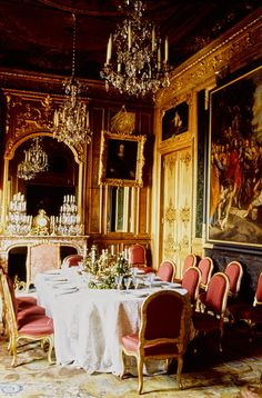 Period settings: In the gallery, Louis XV chairs covered in scarlet surround the table draped with a Venetian lace tablecloth. The painting of a scene from the life of Christ once hung in Marie de' Medici's private chapel.
