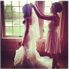 Must have a picture of me helping my sister get ready on her wedding day