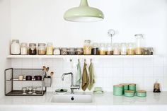 Cooking material organization above kitchen counter