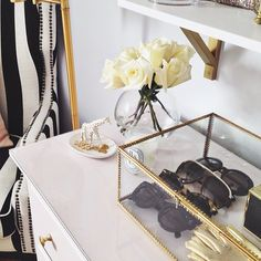 A nice and refreshing way to display sunglasses on your dresser using glass shadow boxes...I love Stephanie's take on style and decor so girly and chic