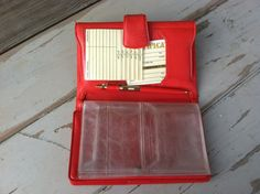 Check out this item in my Etsy shop https://www.etsy.com/listing/236229635/retro-tomato-red-wallet-by-ambassador