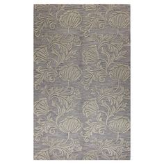 Anchor your living room seating group or define space in the den with this artfully hand-tufted wool and art silk rug, featuring a botanical-inspired motif f...