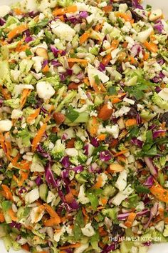 Crunchy Detox Salad With Cauliflower, Broccoli, Red Cabbage, Carrots, Fresh Parsley, Celery Ribs, Almonds, Sunflower Seeds, Olive Oil, Lemon Juice, Fresh Ginger, Clover Honey, Sea Salt
