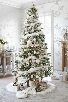 Beautiful silver and white Christmas tree and decor with animal theme
