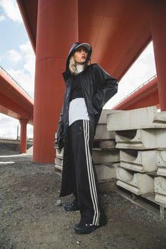 ebc6ee4cf10c72 Long rain coat by danish brand Rains. Pants by adidas Originals.
