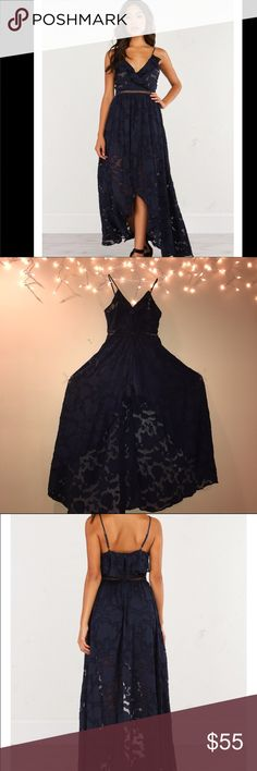 Romper/Dress BRAND NEW, NO TAG! Dress is transparent throughout the chest area, but has flower designs that cover some parts. The dress slits right down the middle to reveal shorts. AKIRA Dresses High Low
