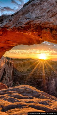 Catch the sunrise from a new vantage point beneath Mesa Arch in Utah:
