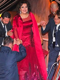 George Clooney & Amal Alamuddin's Whirlwind Wedding Weekend | FAMILY AFFAIR | That's one glowing mother of the bride! After a Saturday of fun and festivities at the Aman Canal Grande, Baria Alamuddin gets ready to hang up her all-red ensemble for the night.