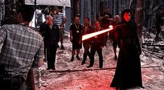 Adam Driver playing with his lightsaber