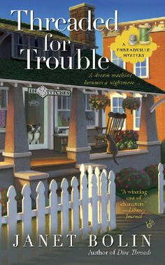 Threaded for Trouble, the second book in the Threadville series by Janet Bolin