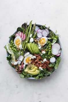 With a strong leafy base, crunchy bits and a creamy dressing, our 6 tips to layering a simple salad is the perfect recipe for spring. #recipe #salad #easyrecipes #vegetarian #realfood #eggs #avocado #foodphotography #foodstyling