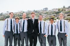 Groomsmen in Ties and Suspenders | Photography: Luke & Katherine Griffin for Max & Friends. Read More: http://www.insideweddings.com/weddings/tent-wedding-with-chic-nautical-theme-on-la-playa-bay-in-san-diego/737/