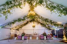 Adding greenery to the ceiling of any event simply bring the out IN! Loving this! Photo Credit: The Kenneys