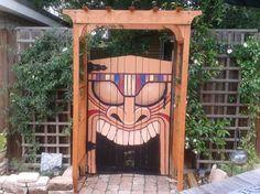 Tiki God Gate leads to a Tropical Garden